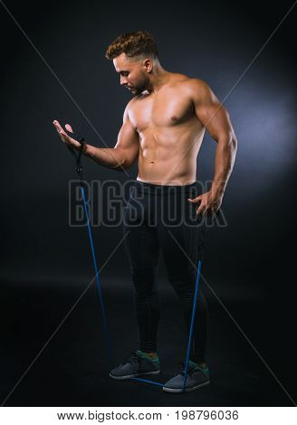 Fitness Man With Elastic Bands