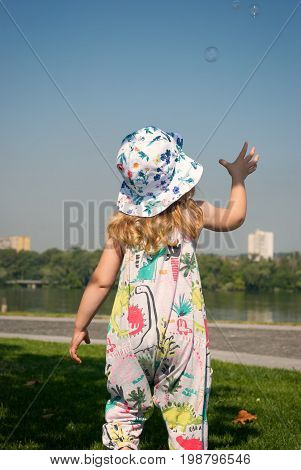 Funny Little Girl Playing With Soap Bubbles