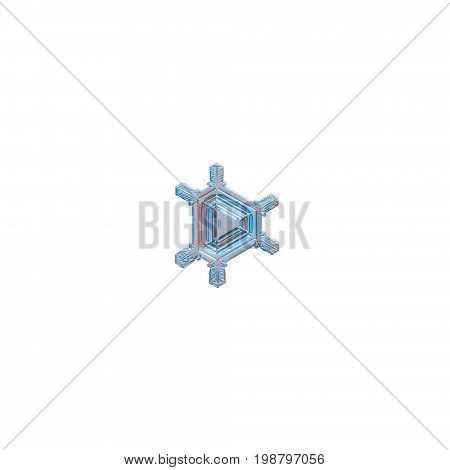 Snowflake isolated on white background. Macro photo of real snow crystal: small triangular snowflake with six short, straight arms and glossy central triangle.