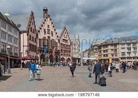 FRANKFURT, GERMANY-JUNE 07, 2015: People on Roemerberg square in Frankfurt, Germany