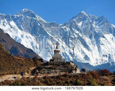 Stupa near Namche Bazar and Mount Everest Lhotse and Nuptse south rock face - way to Everest base camp - Nepal