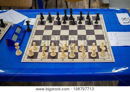 All chess pieces on chessboard before the start game.
