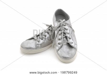 Silver, casual sneakers isolated on white background
