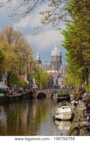 Boats and traditional houses of cannal street in autumn Amsterdam Netherlands