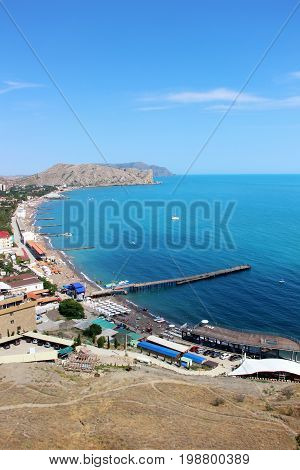 The beach town of Sudak in Crimea the view from the top of the mountain. Summer the Black sea.