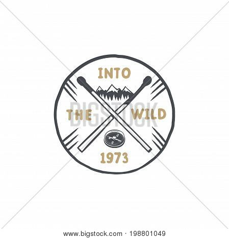 Vintage hand drawn survival badge and emblem. Hiking label. Outdoor inspirational logo. Typography retro style. Motivational quote - Into the wild. For prints, t shirts. Stock vector isolated.