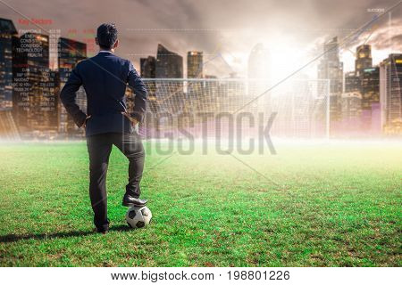 Asian Businessman With Football In The Stadium Foolball.