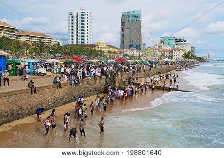 COLOMBO, SRI LANKA - MAY 17, 2011: Unidentified people relax at the seaside in Colombo, Sri Lanka.