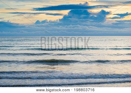 Calm Sea In The Evening And Gloomy Clouds On The Horizon