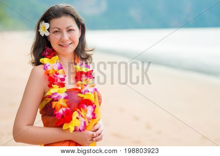 Horizontal Portrait Of A Woman On The Beach In Floral Hawaiian Lei