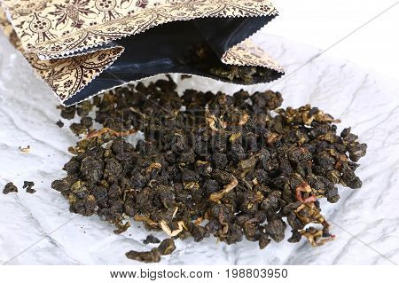 Bag with oolong chineze green tea on plate