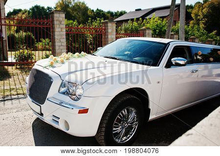 Wedding Decorated White Limousine Riding On The Road.