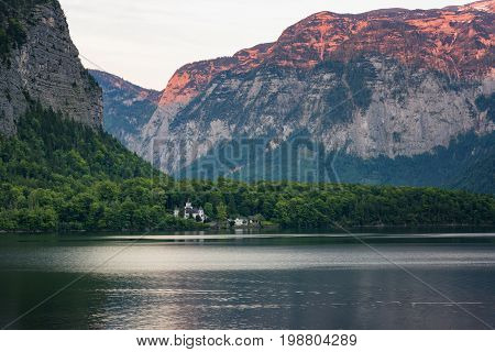 Classic postcard view of famous Hallstatt lakeside town in the Alps on a beautiful sunny day in the summer, Salzkammergut region, Austria