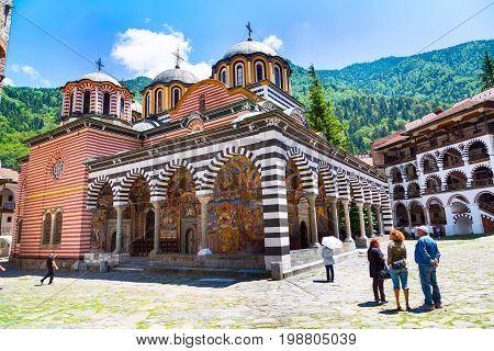 Rila, Bulgaria - June 25, 2015: People near the church in Rila monastery, Rilsky monastery or Monastery of Saint Ivan of Rila