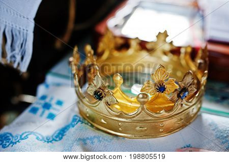 Close-up Photo Of Crowns In The Church Meant For Wedding Ceremony.