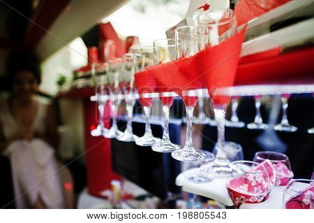 Close-up Photo Of Champagne Glasses In The Limo.