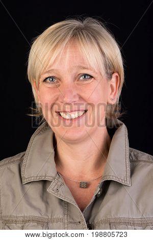 beautiful caucasian mature woman in khaki shirt  - photograph on black background