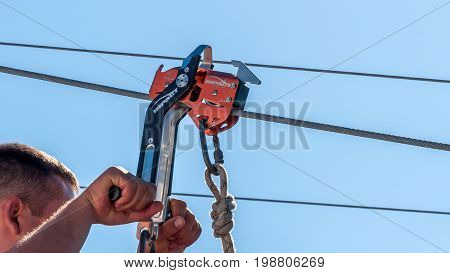Ukraine Migea - July 30 2017: Automatic brake unit Head Rush Zip Stop for high-speed lines Zipline and for trolley lines. Equipment for safe trolling on a steel cable. Roller for high-speed zipline.