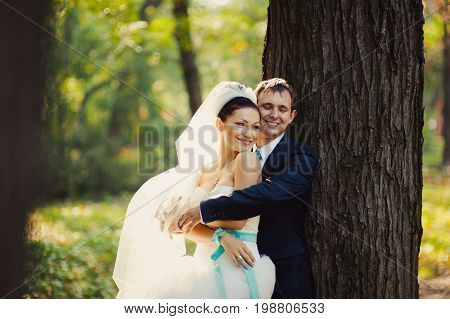 Loving Wedding Couple On A Walk In The Park