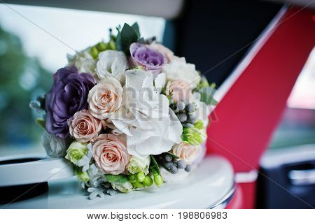 Close-up Photo Of Wedding Bouquet In The Limo.
