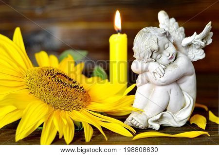Condolence card with angel, flower and burning candle