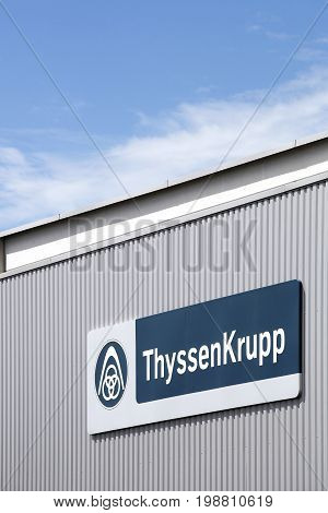 Meyzieu,  France - July 29, 2017: Thyssenkrupp logo on a wall. Thyssenkrupp is a German multinational conglomerate, based in Duisburg and Essen and divided into 670 subsidiaries worldwide