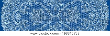 Vertically seamless white lace with floral pattern on dark blue background