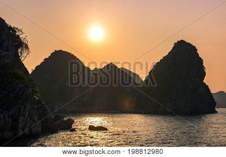 Romantic Halong Bay Sunset Over Limestone Rocks, Vietnam
