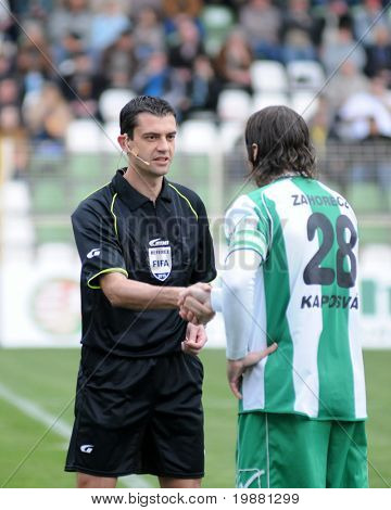 KAPOSVAR, HUNGARY - MARCH 27: Kassai (L) and Zahorecz shake hands before a Hungarian National Championship soccer game Kaposvar vs Paks March 27, 2010 in Kaposvar, Hungary.