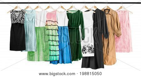 Set of dresses hanging on clothes racks on white background