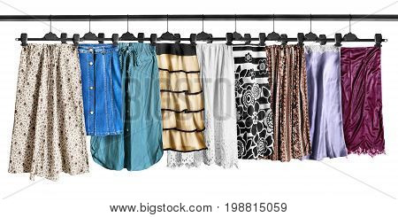 Set of midi skirts hanging on clothes racks isolated over white