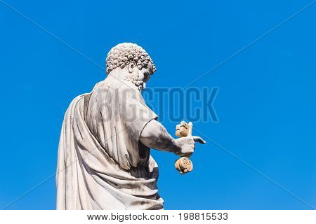 VATICAN CITY VATICAN - OCTOBER 16 2016: Statue Saint Peter holding a key in front of St Peter's Basilica on piazza San Pietro