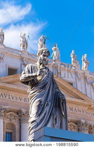 VATICAN CITY VATICAN - OCTOBER 16 2016: Statue Saint Peter in front of St Peter's Basilica on piazza San Pietro