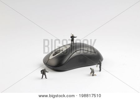 Tiny  Swat Team On Top Of Computer Mouse.