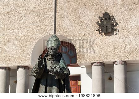 WADOWICE POLAND August 5 2017: Wadowice is the place of birth of Pope John Paul II. Church of St. Peter the Apostle. Statue of the Pope John Paul II