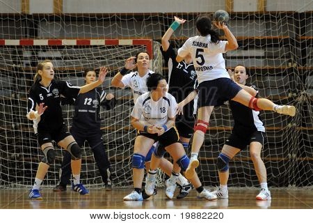 KAPOSVAR, HUNGARY - APRIL 18: Szabina Reichert (with the ball) in action at Hungarian Handball National Championship II. match (Kaposvar vs. Csurgo) April 18, 2010 in Kaposvar, Hungary.