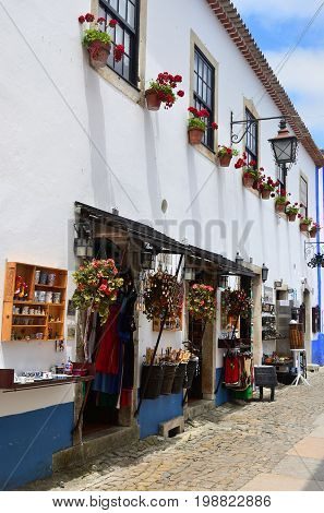 Souvenirs On The Streets Of The Picturesque Town Of Obidos, Portugal
