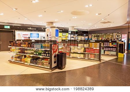 Zurich Switzerland - June 11 2017: Airport Zurich duty free shop with bottles of alcohol and cigarettes