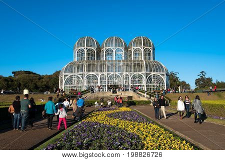 Curitiba, Brazil - July 21, 2017: People visit famous Botanical Garden of Curitiba, Brazil. The garden was opened in 1991 and covers 240.000 m2 in area.