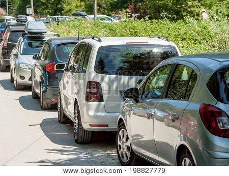 narrow street near river problems with parking traffic jam