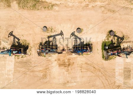 Aerial view of the row of oil derricks in summer