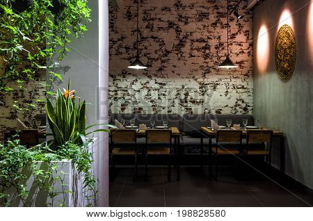 Moscow - August 5, 2017: Interior of a Thai restaurant with brick wall