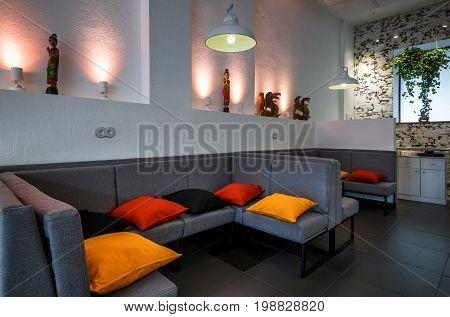 Moscow - August 5, 2017: Interior of a Thai restaurant room with a couch and pillow