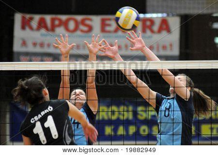 KAPOSVAR, HUNGARY - APRIL 13: Csarko (L), Ihasz (C) and T. Kondor (R) in action at the Hungarian NB I. League woman volleyball game Kaposvar vs Miskolc, April 13, 2010 in Kaposvar, Hungary.