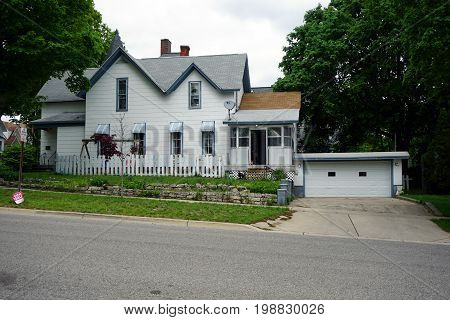CADILLAC, MICHIGAN / UNITED STATES - MAY 31, 2017: An elegant single family home with an attached two-car garage, in the Courthouse Hill Historic District of Cadillac, Michigan.