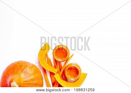 Baby food. Pumpkin puree on white background top view