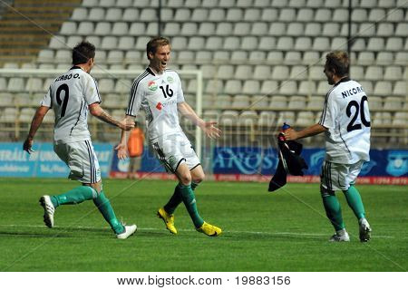 KAPOSVAR, HUNGARY - MAY 8: Gyor players celebrate a goal at a Hungarian National Championship soccer game Kaposvar vs. Gyor - May 8, 2010 in Kaposvar, Hungary.