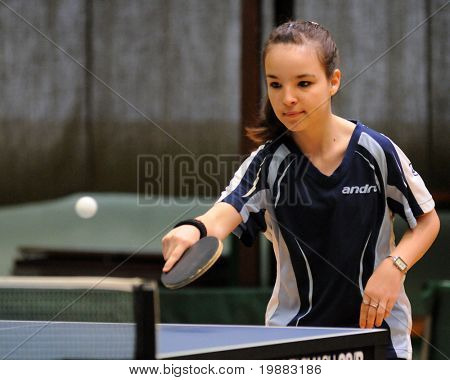 KAPOSVAR, HUNGARY - MAY 8: Dora Hujber in action at a Hungarian National Championship II. table tennis game Kaposvar vs. Dunaszekcso May 8, 2010 in Kaposvar, Hungary.