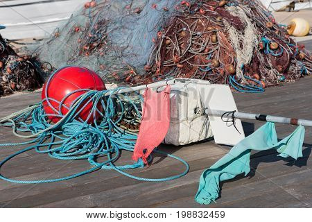 Fishing net and buoys in the harbor in the sun