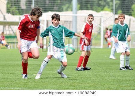 KAPOSVAR, HUNGARY - MAY 9: Adam Kiss (L) and Bence Kiss (C) in action at the Hungarian National Championship under 15 game between Kaposvari Rakoczi and Nagykanizsa May 9, 2010 in Kaposvar, Hungary.
